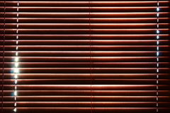 Sunlight behind vertical blinds. Blinds wood pattern closed sunlight Stock Image