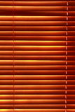 Sunlight behind vertical blinds Royalty Free Stock Image