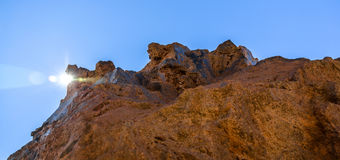 Sunlight behind Volcanic Rock Stock Photos