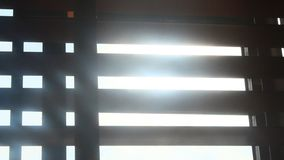 Sunlight through blinds stock video footage