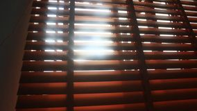 Sunlight through blinds stock footage
