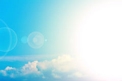 Sunlight in blue skies. Background of white clouds and sunlight in blue skies Royalty Free Stock Photo