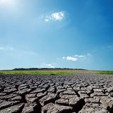 Sunlight in blue sky over drought earth Stock Photo