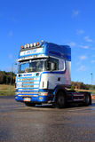Sunlight on Blue and White Scania L164 Truck in Autumn Stock Photo