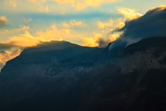 Sunlight breaking through the clouds over a mountain. In the Alps Royalty Free Stock Image