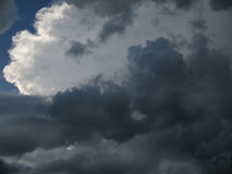 Sunlight breaking through dark thunderclouds. Royalty Free Stock Images