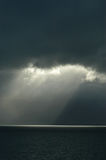 Sunlight breaks through black clouds. Arctic Ocean in Iceland Royalty Free Stock Photos