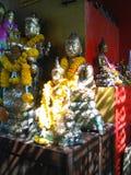 Sunlight on Buddha statutes Royalty Free Stock Photo
