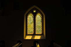 Sunlight casting colours through Gothic Stained glass window Royalty Free Stock Images