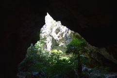 Sunlight through cave hole Stock Image