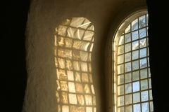 Sunlight on a church wall. Sunlight trough a church window spreads nicely on the wall Royalty Free Stock Image