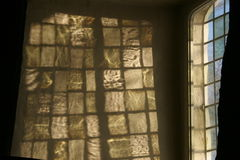 Sunlight on the church wall. The sun is painting a nice pattern on  an old churchwall Royalty Free Stock Images
