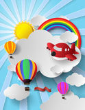Sunlight on cloud with hot air balloon and airplane Royalty Free Stock Images