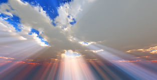 Sunlight through the clouds. Rays of sunlight through the clouds Royalty Free Stock Photo