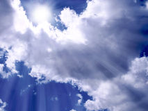 Sunlight between the clouds. Sunlight between clouds and blue sky Stock Image