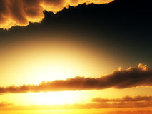 Sunlight In Clouds. Sunlight from the sun in a cloudy sunset sky Royalty Free Stock Images