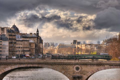 Sunlight and clouds over Pont Louis-Philippe Stock Image