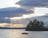 Sunlight through clouds Stock Image