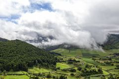 Sunlight and clouds. Dance among pastures and forests in the Sete Cidades Caldera on Sao Miguel in the Azores royalty free stock images