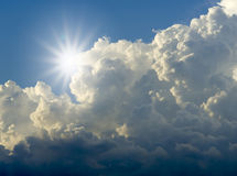 Sunlight. And cloudy blue sky Royalty Free Stock Photo
