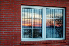 Sunlight. Colorful evening sun rises in windows Stock Photo
