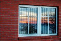 Sunlight. Colorful evening sun rises in windows Stock Photo