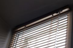 Sunlight coming through venetian blinds by the window . stock image