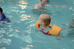 Sunlight dancing on swimming pool late in the day royalty free stock photos