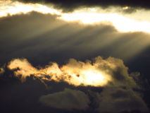 Sunlight through the dark clouds Stock Photography
