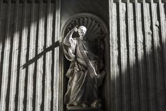 Sunlight from the dome of st Peter`s cathedral over apostle paul. `s statue Stock Photo