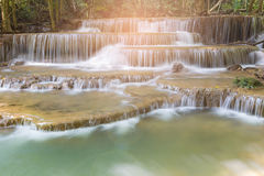 Sunlight effect natural stream waterfall in tropical deep forest Stock Image