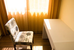 Sunlight in empty room. Empty room with single table and chair under sunlight Stock Images