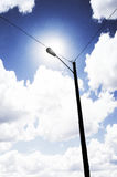 Sunlight & Energy. The sun shining behind a lamp post Royalty Free Stock Photography