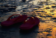 Sandle with sunset sunlight fallen. Beautiful sunlight fallen into the reddish slippers around the beach area photograph stock image