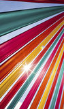 Sun flare through coloured ribbons Royalty Free Stock Images