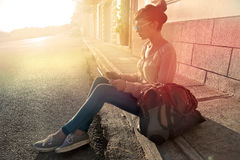Sunlight. A girl sitting on the ground in the sunlight Stock Photo