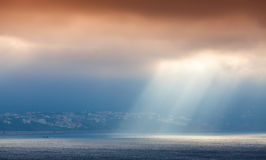 Sunlight goes through clouds. Bay of Tangier Stock Photography