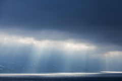 Sunlight goes through stormy clouds Royalty Free Stock Image