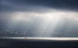 Sunlight goes through stormy clouds Royalty Free Stock Images