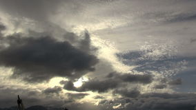 Sunlight through gray clouds time lapse stock video footage