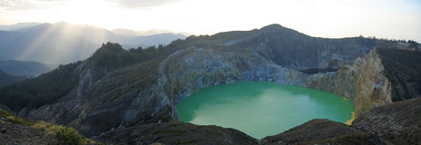 Sunlight on the green crater. Lake - Kelimutu volcano - Flores - Indonesia - Panorama Royalty Free Stock Images