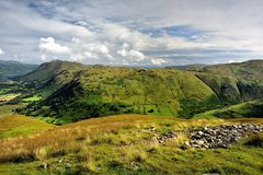 Brock Crags from Hartsop Dodd. Sunlight on the green fields of Brock Crags Stock Photography