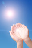Sunlight through the hands. Sunlight from the blue sky is coming through the hans stock photography