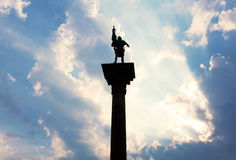 Sunlight illuminating monument. Sunshine illuminating statue place on a column stock photos