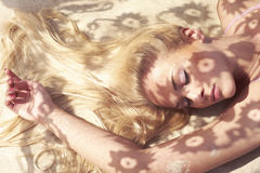 Sunlight through the lace. Beautiful blonde and the sun's rays through the lace Stock Image