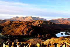 Sunlight on the Loughrigg Fell. Early morning sunlight over the Coniston Fells Stock Images