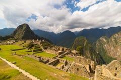 Sunlight at Machu Picchu, Peru, with scenic sky Royalty Free Stock Photo