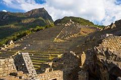 Sunlight on Machu Picchu terraces from below, Peru Royalty Free Stock Photos