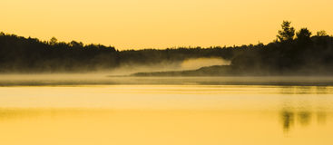 Sunlight on Mist and Water Royalty Free Stock Photography