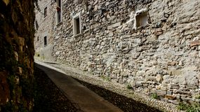 Alleyway And Stone Walls stock image